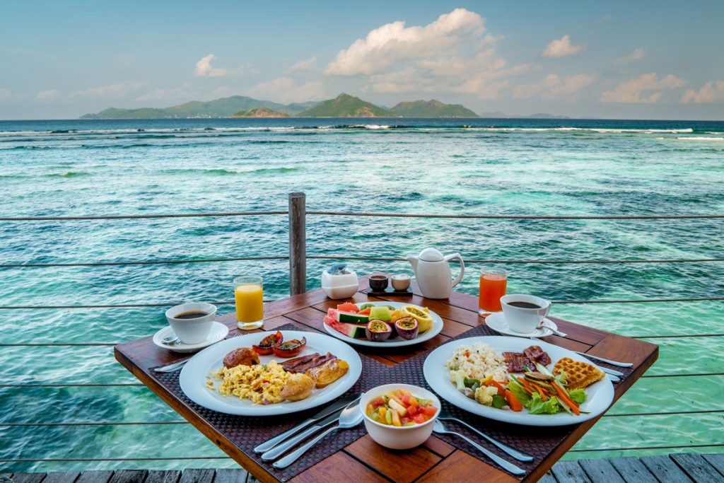 luxury breakfast with a look at the ocean of La Digue Seychelles By Fokke